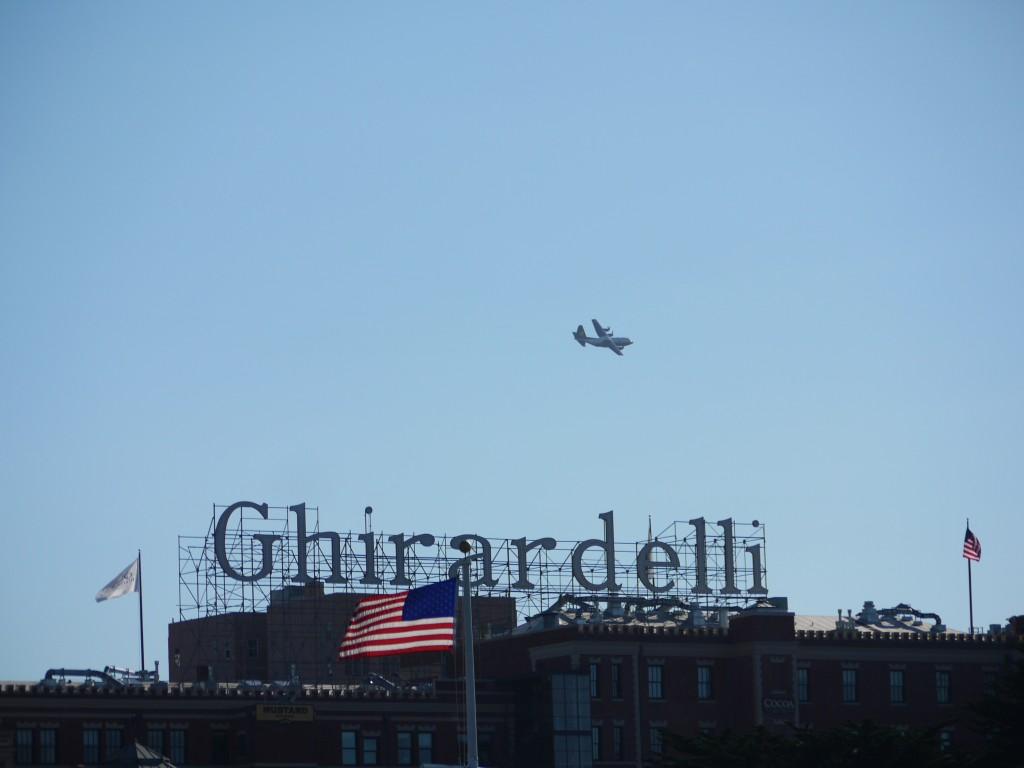 US Marines Lockheed-Martin C-130T Hercules flying past Ghirardelli's