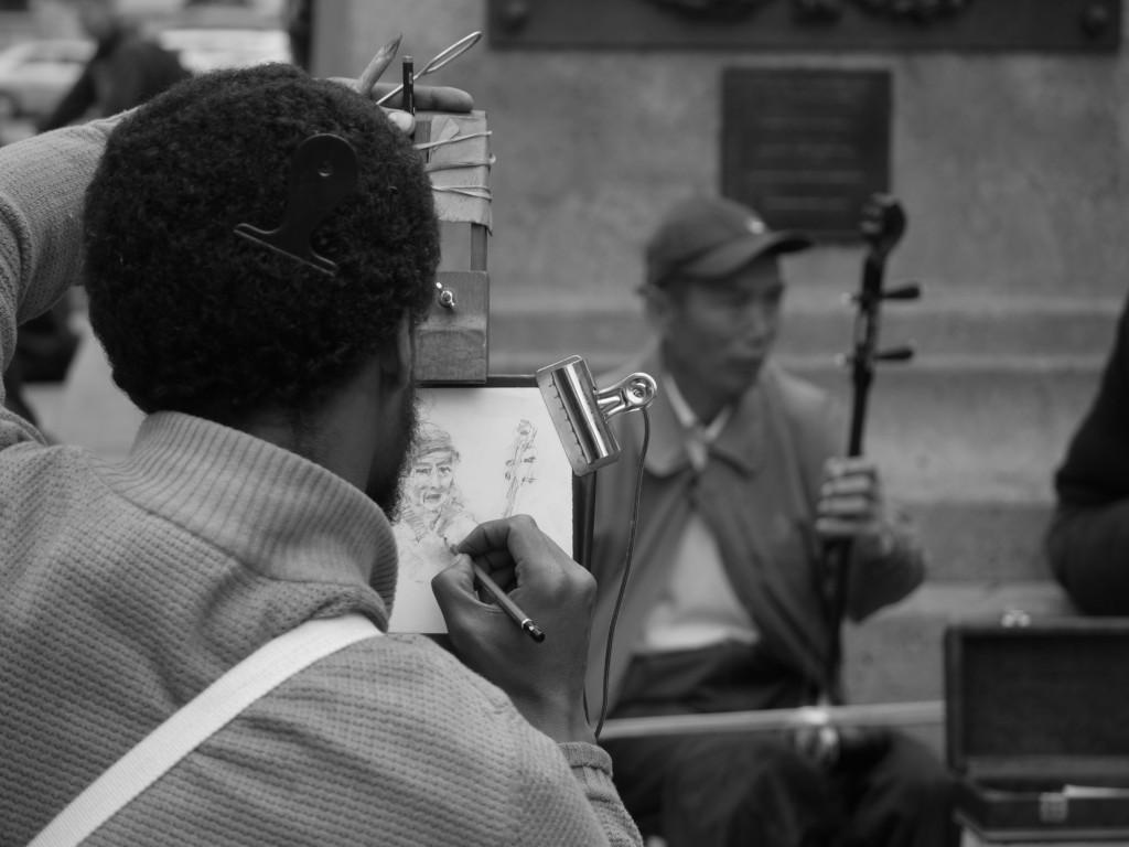 Artist sketching Erhu player.
