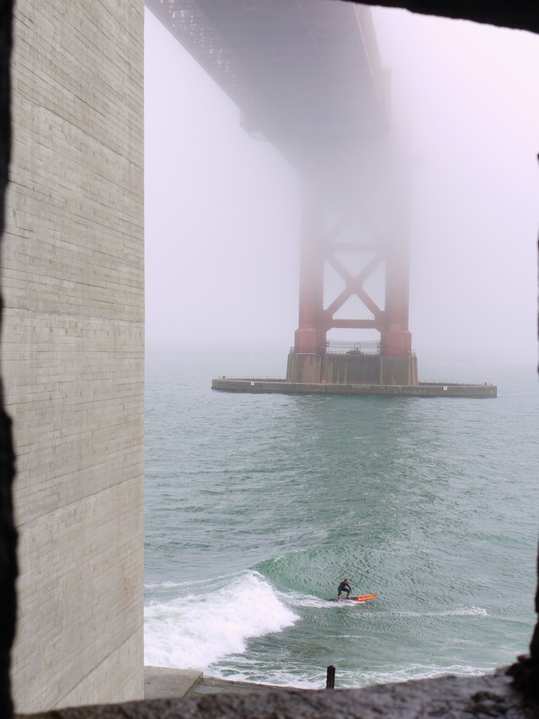 Paddle boarding under the Golden Gate Bridge.